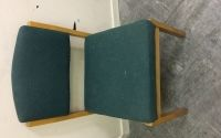 Wooden frame green padded chairs